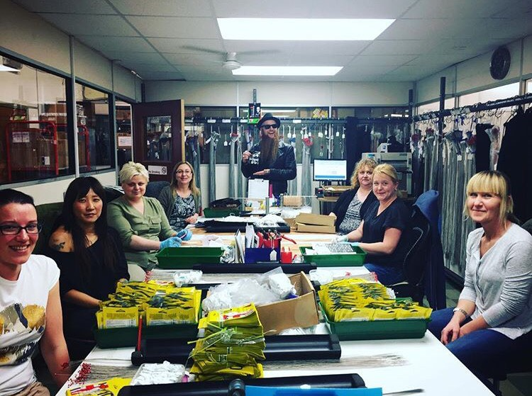 Once strings are finished being wound, they're quality checked, grouped and packaged by these hard working women. Thanks for ensuring every single string and set goes out perfect!